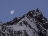 Moon setting over a snow capped peak along the trail up to the Cho La (pass).