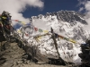 Prayer flags marking the top of Chukhung Ri (5559m/18,238 ft) with the Nuptse-Lhotse wall behind, above Chukhung.
