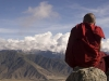 Monk on the high kora route overlooking Ganden Monastery.