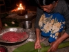 Preparing a special Konyak dish of pork mixed with rice cooked inside a bamboo stalk