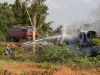 Firefighters attempting to put out the flames on an overturned petrol tanker, south of Hospet.