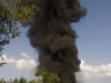 Smoke plume from the burning petrol tank on an overturned tanker, south of Hospet.