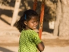 Upset girl on a swing, Hampi.