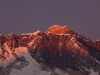 Mt. Everest peaking above the Nuptse Lhotse ridge at sunset from Deboche