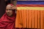 Monk watching Cham dance, Hemis Festival.