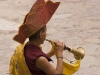 Monk playing horn, Hemis Festival.