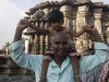 Pilgrim holds up little girl in front of the Channekeshava Temple, Belur.