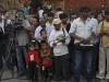 "Film crew and ""boom box holder,"" Durbar Square, Kathmandu."