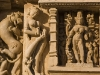 Woman applying henna to her foot, Parsvanath Jain temple, Khajuraho.