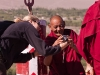 Karin shows a photo to a monk, Thiksey Gompa