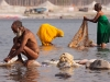 Sadhu and women washing clothes, Kumbh Mela, Haridwar