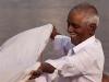 Man drying cloth, Kumbh Mela, Haridwar