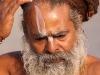 Sadhu decorating his forehead, Kumbh Mela, Haridwar