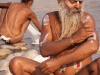Sadhu decorating his arm, Kumbh Mela, Haridwar
