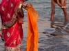 Woman washing a sari, Kumbh Mela, Haridwar