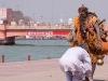 Man pays respect to passing Sadhu, Kumbh Mela, Haridwar