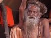 Naga Sadhu who took a vow to keep his hand above his head, Kumbh Mela, Haridwar