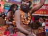 Naga Sadhus walk to Hari-Ki Pairi Ghat to take their bath in the Ganga on Somvati Amavasya - Dvitya Shahi Snan, Khumbh Mela, Haridwar