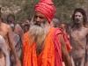 Naga Sadhus return from taking their baths in the Ganga at Hari-Ki Pairi Ghat on Somvati Amavasya - Dvitya Shahi Snan, Khumbh Mela, Haridwar