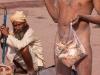 Naga Sadhu accepting alms, Somvati Amavasya, Kumbh Mela, Haridwar