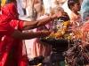 Women worshiping at a Peepal tree on Somavati Amavasya