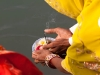 Women offering flowers to the Ganga on Somavati Amavasya