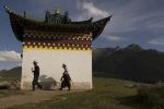 Pilgrims performing kora, circumambulation of a monastery in Langmusi.