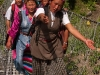 Women of Langtang singing on their way down to retrieve articles for a new gompa