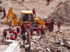 Monks helping to remove ruble a day after the flash flood in Leh, August 6 2010