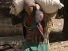 Woman carrying a heavy load in Kagbeni.