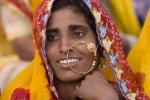 Smiling woman watching the closing ceremonies of Pushkar Camel Fair.