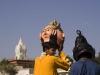 "A kid takes a peak out of his mask during the ""Spiritual Walk,"" Pushkar Camel Fair."
