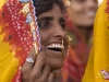 Woman amused by the tug-of-war result while watching the closing ceremonies of Pushkar Camel Fair.