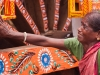 Pilgrim overcome with emotion during preparations for the Rath Yatra in Puri