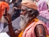 Sadhu takes a picture with his cell phone, Rath Yatra, Puri