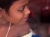 Girl puts on paint like Henna, Puri