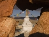 Stupa through rock formation, at the Tirthapuri monastery
