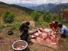 Preparing the beef for lunch during the rice harvest in Shiyong