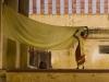 Woman hangs out a sari to dry, Sri Meenakshi Temple, Madurai.