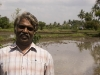 Man who showed me around Kumbakoram, in front of his land outside of town.
