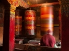 Spinning a prayer wheel, Tawang, Gompa