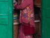 Woman in traditional dress, market Tawang