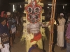 Man bowing before Theyyam, Kannur District.