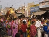 Swami leading a procession through the streets of Ujjain on the back of an Elephant.