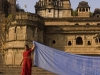 Laying saris out to dry along the ghats in Maheshwar