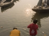 Man and child bathing in the Ganges at sunrise, Varanasi.