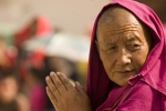 Monk watching the performance during the festival at Labrang monastery, Xiahe.