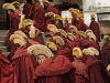 Monks entering the main prayer hall, Labrang monastery, Xiahe.